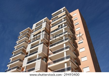 Tall apartment building in Benidorm, Spain. Residential architecture.
