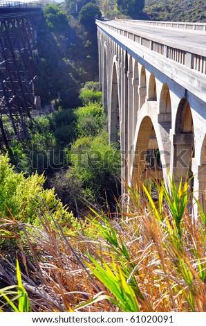 Tall bridge across gorge.