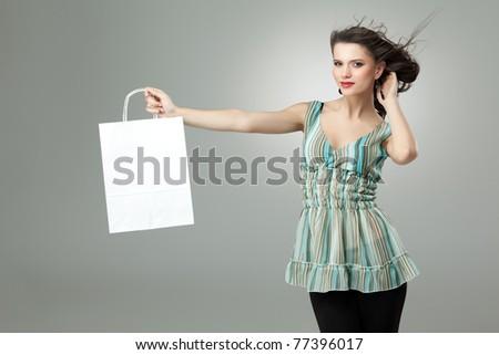 tall brunette woman shopping white bag wind