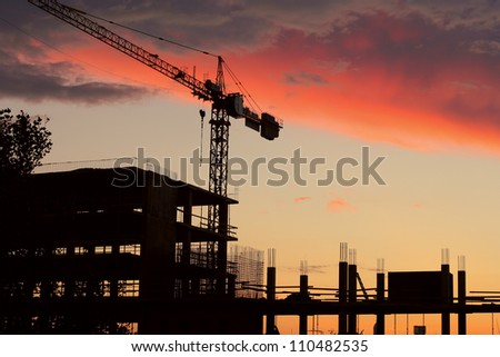 Tall building under construction over beautiful sunset sky