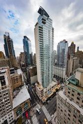 Tall buildings along the New York skyline above 5th Avenue
