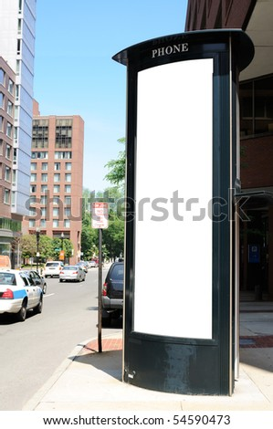 Tall commercial sign on telephone booth. Clipping path included.
