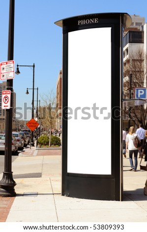 Tall commercial sign on the city, people in the background. Clipping path included. - stock photo