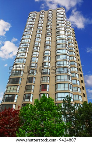Tall condominium or apartment building in the city - stock photo
