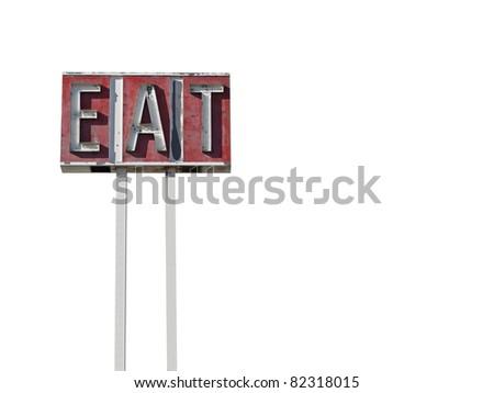 Tall eat sign ruin along a California desert highway.