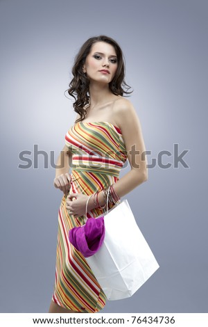 stock photo : tall girl seductive stripes dress colors
