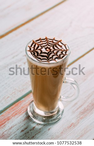 Tall Glass Latte on Wooden Background #1077532538