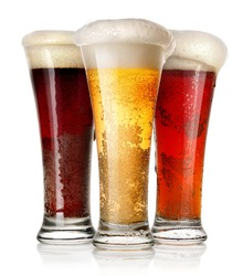 Tall glasses of beer isolated on a white background