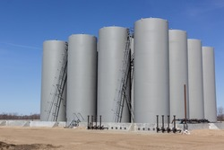 tall grey storage tanks