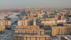 Tall new buildings in a Russian winter city. New residential areas of Penza with houses in winter. Sleeping area of the city of Penza. Penza city from above. Houses under construction