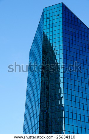 Tall office building with reflection