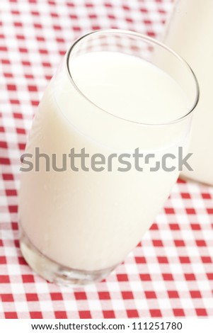 Tall Organic Glass of White Milk on a background