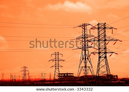 Tall power lines during sunset in the evening