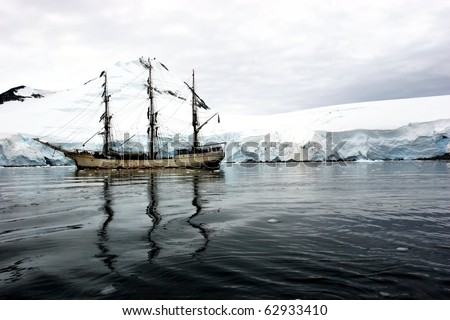 Tall sailing ship with three masts in Antarctica