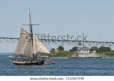 Tall Ship in Front of Rose Island Lighthouse