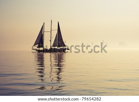 tall ship sailing along skyline - stock photo
