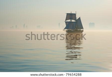tall ship sailing into fog