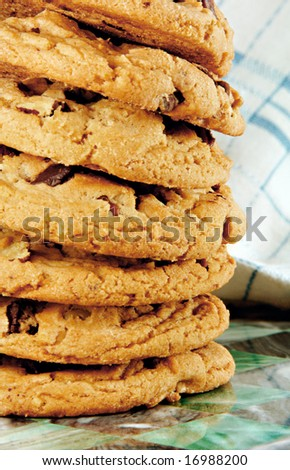 Tall stack of chocolate chip cookies fresh from the oven.