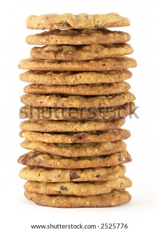 Tall stack of homemade chocolate chip cookies isolated on white background.