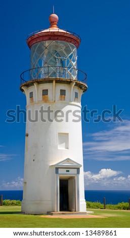 Tall white stucco lighthouse with red roof (Kilauea, Kauai)