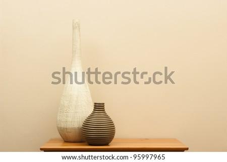 Tall white vase and short striped vase still life - horizontal