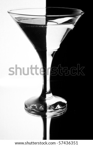 tall wine glass for a martini on a black background