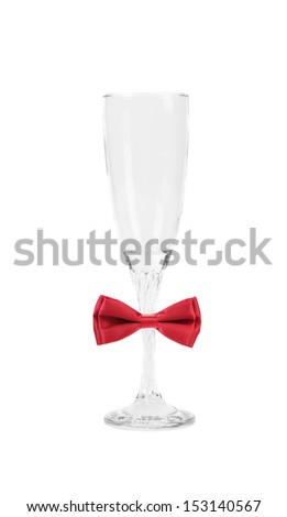 Tall wineglass and red bow tie.