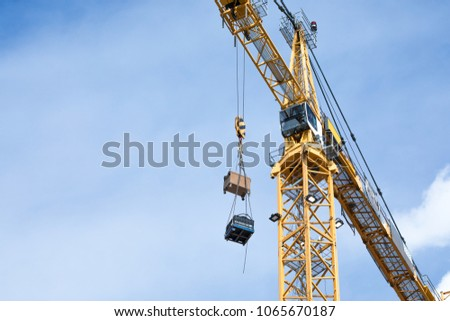 tall yellow tower crane  with...