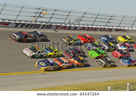 TALLADEGA, AL - OCT 31:  The NASCAR Sprint Cup Series teams take to the track for the AMP Energy Juice 500 race  on Oct 31, 2010 at the Talladega Superspeedway in Talladega, AL. - stock photo