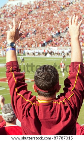 TALLAHASSEE, FL - OCT. 22:  Florida State football fan stands up and cheers at a home game as the FSU Seminoles play the Maryland Terps at Doak Campbell Stadium on Oct. 22, 2011.