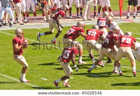 TALLAHASSEE, FL - OCT. 16:  Florida State University's quarterback, Christian Ponder (#7), looks for open receiver while Boston College presses forward on October 16, 2010 at Doak Campbell Stadium.