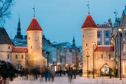 Tallinn, Estonia. Famous Landmark Viru Gate In Street Lighting At Evening Or Night Illumination. Christmas, Xmas, New Year Holiday Vacation In Old Town. Popular Touristic Place