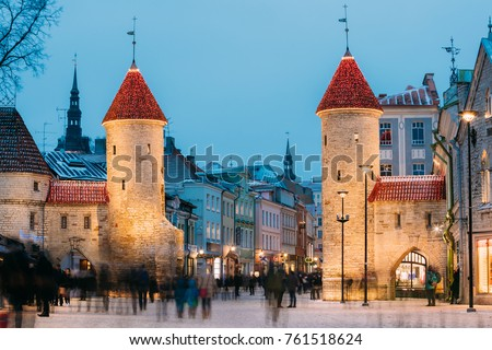 Tallinn, Estonia. Famous Landmark Viru Gate In Street Lighting At Evening Or Night Illumination. Christmas, Xmas, New Year Holiday Vacation In Old Town. Popular Touristic Place #761518624