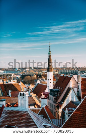 Tallinn, Estonia. Tower Of Church Of Holy Ghost Or Holy Spirit Is Medieval Lutheran Church Located Behind Raekoja Plats, Opposite Great Guild And Maiasmokk And Roofs Of Other Houses In Winter Day. Stock fotó ©
