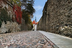 TALLINN, Estonia. View to Pikk Jalg (Long leg) Street in Tallinn old town.  Autumn, fall season.