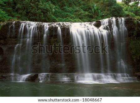 Talofofo Falls, Guam. Scenic island waterfall. A travel tourist attraction destination in Marianas Micronesia.