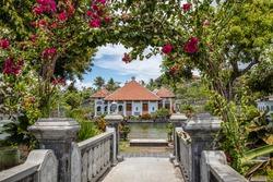 Taman Ujung Sukasada (Taman Ujung Water Palace) through Bougainvillea archway, Bali Island, Indonesia