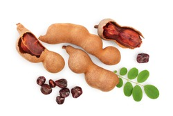 Tamarind fruit with leaf and seed isolated on white background, Top view. Flat lay