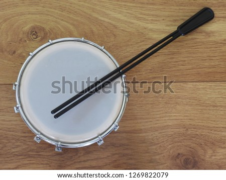 Tamborim with drumstick, a Brazilian musical percussion instrument, widely used to accompany samba, the famous Brazilian rhythm. It has a great prominence in the Brazilian carnival.