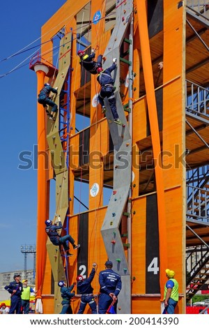 TAMBOV, RUSSIA - JUNE 16, 2014:  All-Union Competition rescue workers in Tambov. Overcoming Obstacle staff rescue. Sunny summer day