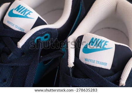 Tambov, Russian Federation - May 10, 2015 New blue Nike waffle trainer shoes. Close-up. Studio shot.