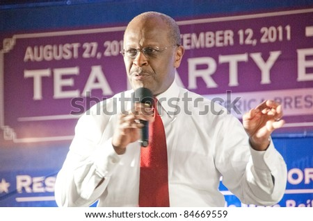 TAMPA - SEPTEMBER 12: Republican candidate Herman Cain addresses supporters after the CNN/Tea Party Express debate in Tampa, Florida on September 12, 2011. - stock photo