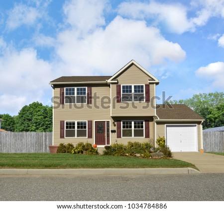 Tan Suburban McMansion Home Blue Sky Clouds USA #1034784886