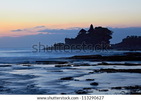 Tanah Lot Temple and ocean waves at sunset, Bali, Indonesia
