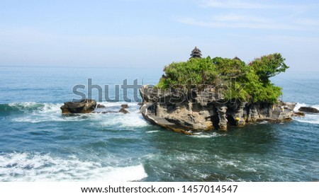 Tanah Lot Temple on the sea in Bali, Indonesia. Bali is a popular tourist destination, which has seen a significant rise in tourists since the 1980s. #1457014547