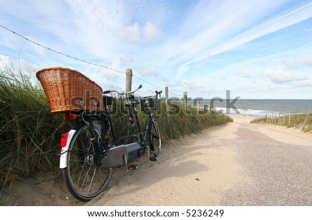 Tandem bike at the beach - stock photo