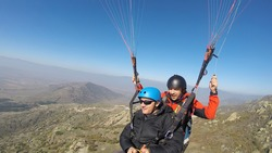 Tandem double paragliding flight