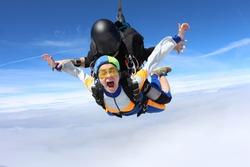 Tandem jump. Fantastic emotions above white clouds.