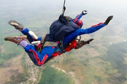 Tandem jump. The girl with the instructor in freefall.