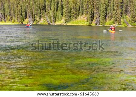 Tandem Kayaks on Big Salmon River, Yukon Territory, Canada - stock photo